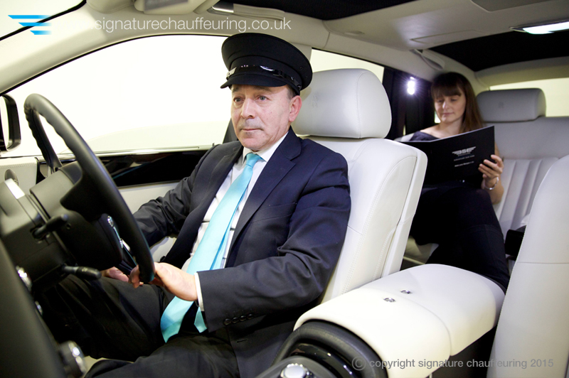 signature-chauffeuring-chauffeur-with-client