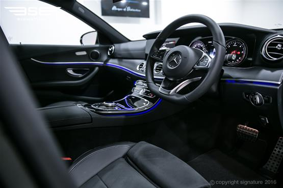 mercedes-e220d-amg-line-side-interior-front